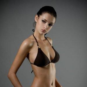 slim woman in black bikini top